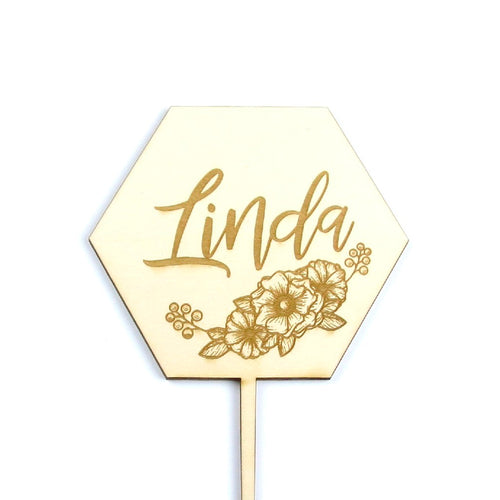 Wooden cake topper with engraved name and florals