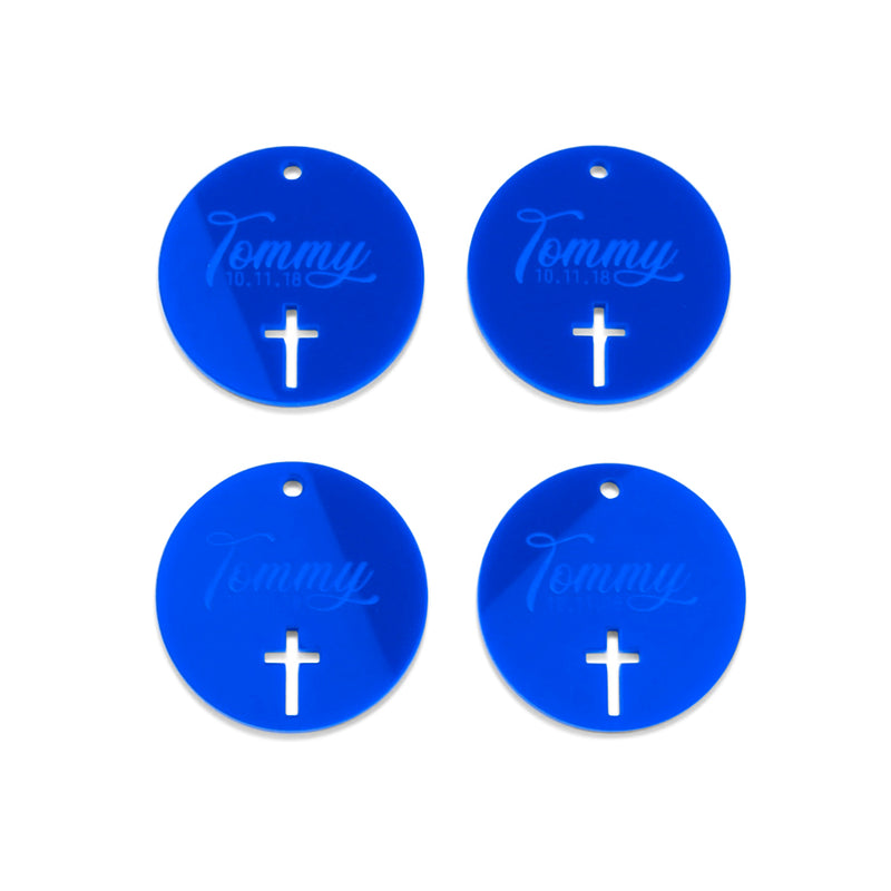 "4 blue acrylic gift tags with ""Tommy 10.11.18"" engraved and cross cut out."