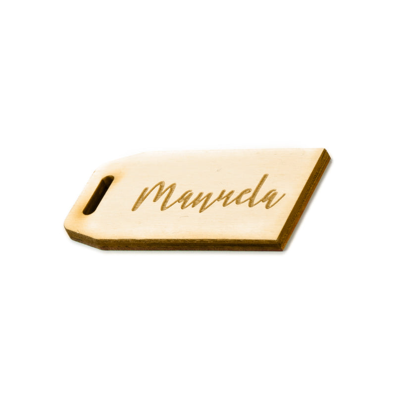 "Wooden bag tag with ""manuela"" engraved"