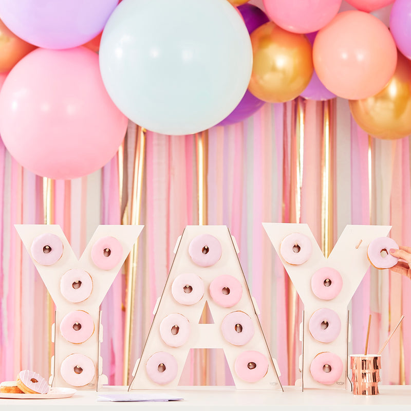 """YAY"" Donut wall on table with balloons"