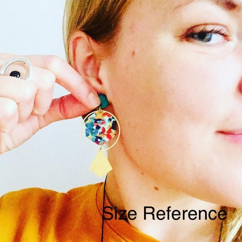 Size reference of handmade geometric polymer clay drop earrings.
