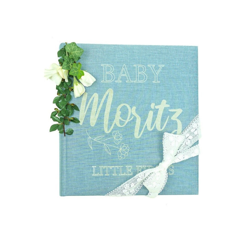 "Blue photoalbum engraved with ""Baby Moritz little firsts"""