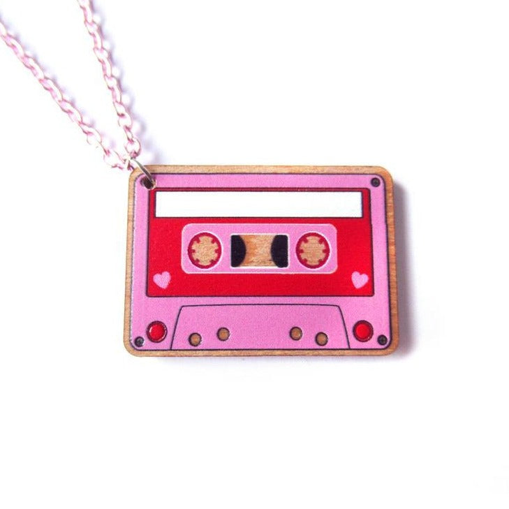 Closeup of pink and red wooden cassette locket with pink chain