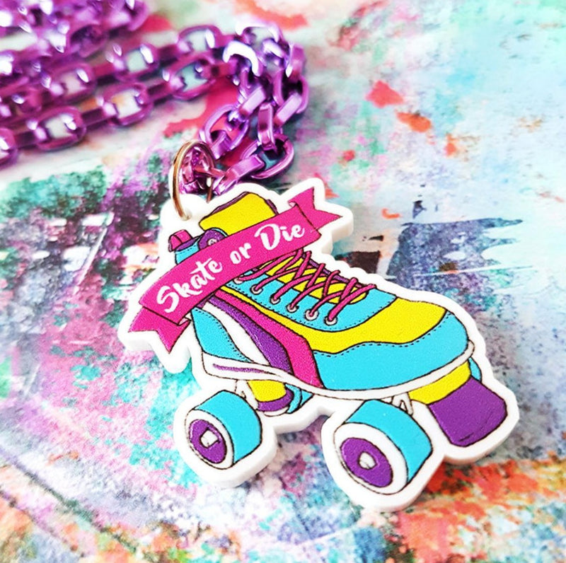 Purple chain with multi-colored skate wooden medallion with skate or die text