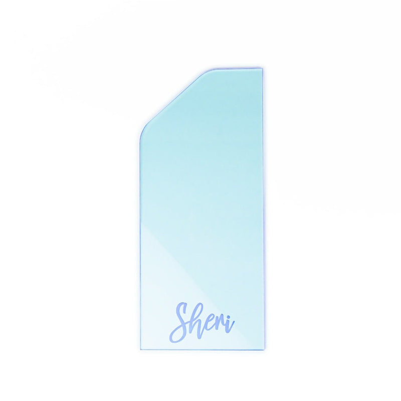 Transparent purple acrylic cake scraper on white background