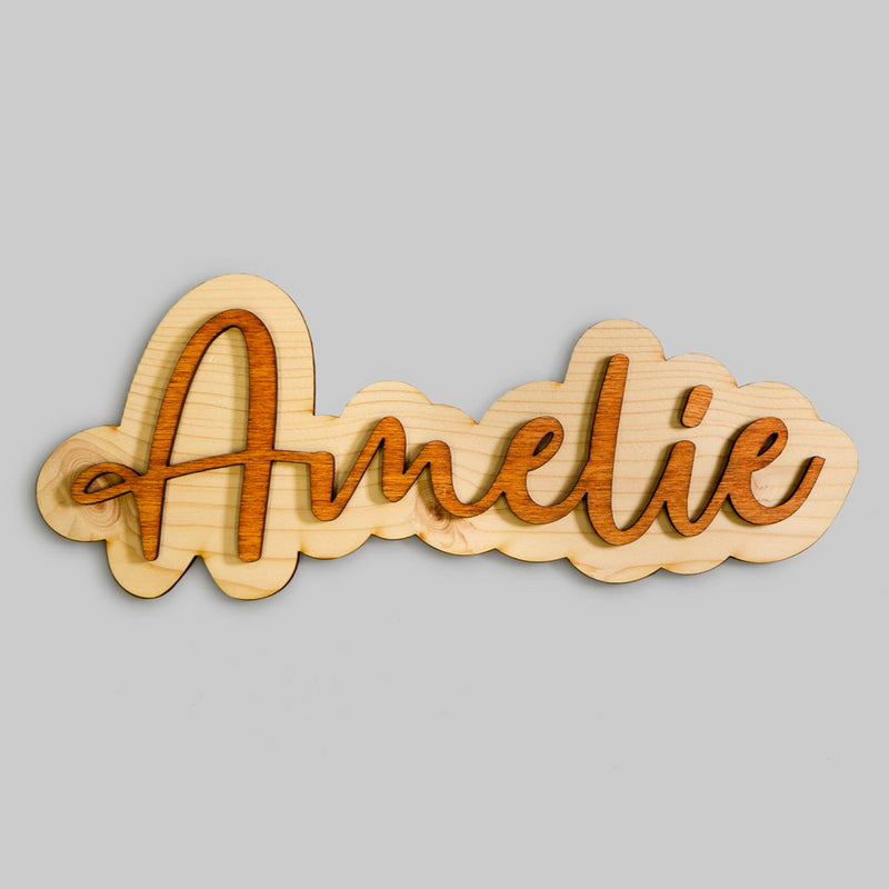 """Amelie"" wooden sign on grey background"