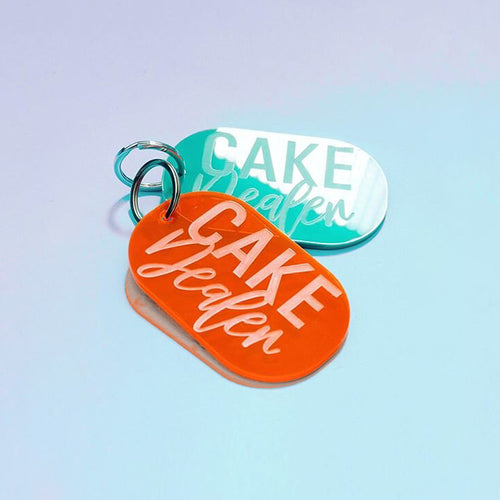 "Acrylic orange and turquoise""Cake Dealer"" keychains"
