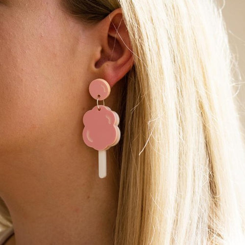 Acrylic cotton candy earrings on ear