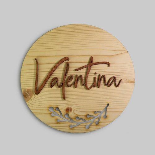 "Round wooden ""Valentina"" name sign with a branch cutout"