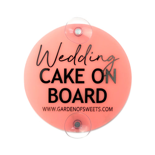 "Frosted pink ""wedding cake on board"" sign for the inside of the car"