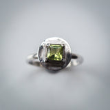 Sterling Silver Ring with a Square Peridot in a Unique Setting