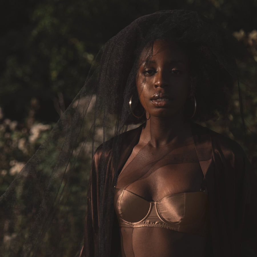 Ma'at Bronze Silk Balconette Bra_campaign_model 2_front_Ihuoma