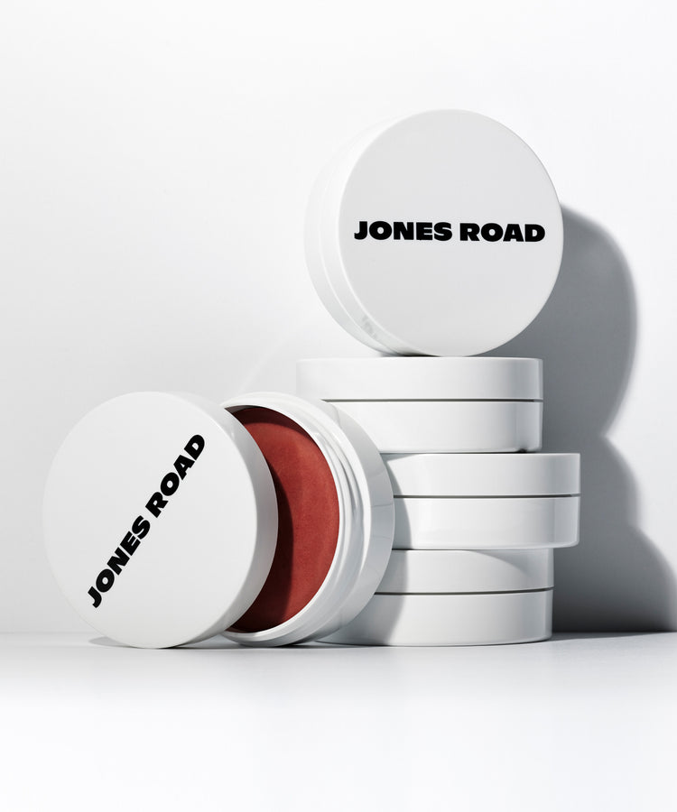 Jones Road clean makeup product containers stacked