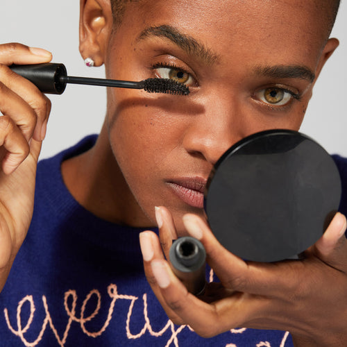 Black woman applying Jones Road clean mascara