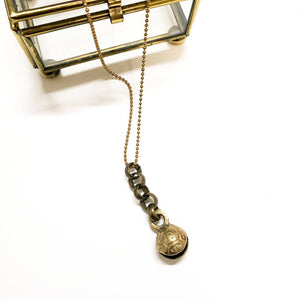 African brass bell necklace