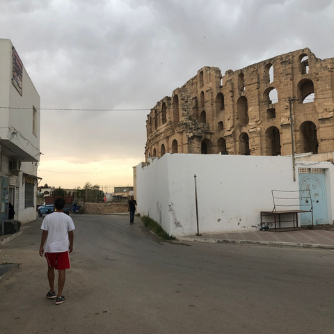 Zwïta co-founder Karim Arem strolling through the city of El Jem