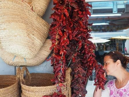 Woman smelling sun-dried chili peppers