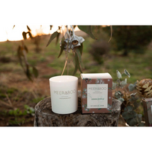 Load image into Gallery viewer, Meeraboo soy candle in white jar and Meeraboo soy candle limited edition gift box sitting together on a wooden trunk in an outdoor setting