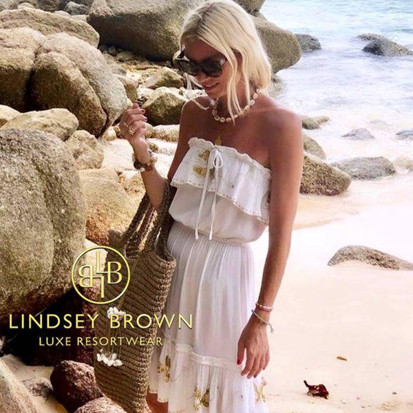 Shop White Strapless Beach dresses seen on Anna Mavridis
