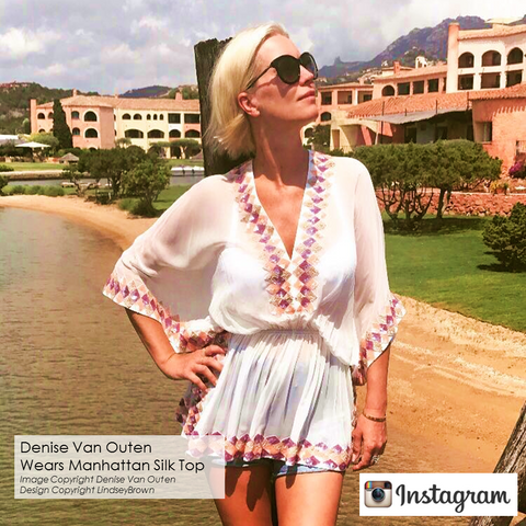 #DeniseVanOuten wears White Silk Kaftan Top in Sardinia . Shop White Silk Tops as seen on #DeniseVanOuten