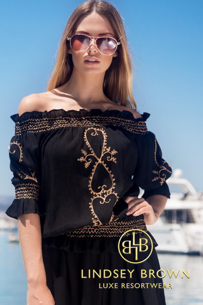 This pretty bardot style off shoulder designer kaftan is new style for Lindsey Brown luxury resort wear