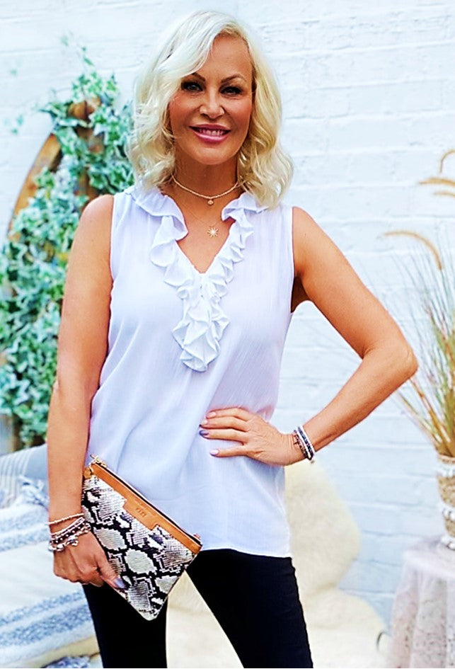 White Sleeveless Ruffles Holiday Top to wear in Caribbean by Lindsey Brown resort wear