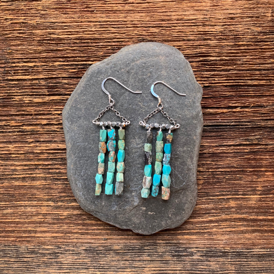 Turquoise dangle earrings. Turquoise beads with silver accents.