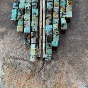African turquoise waterfall necklace. Raw turquoise beads and accents of silver.