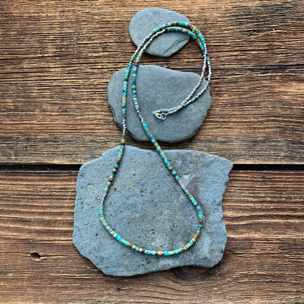 Turquoise hand cut beaded necklace.