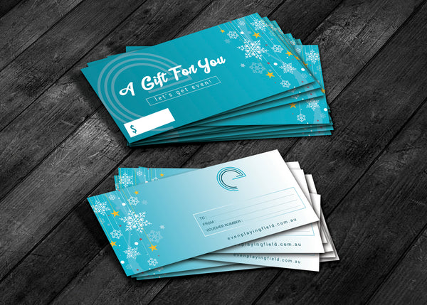 Gift certificates are shown in two piles on a wooden surface.