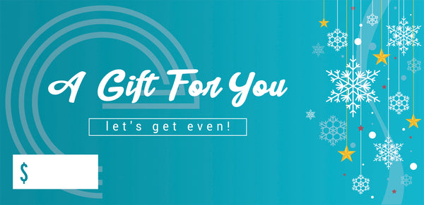 "The front of the gift certificate, which is teal blue with white snowflakes and has ""A gift for you"" and ""let's get even!"" written on them. There is a blank space for the amount of the voucher to be written in."