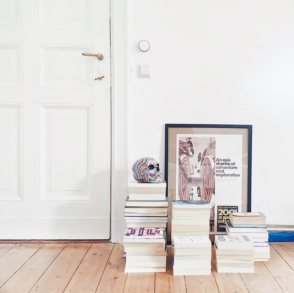 Books by Black Authors - Stack of books in a space