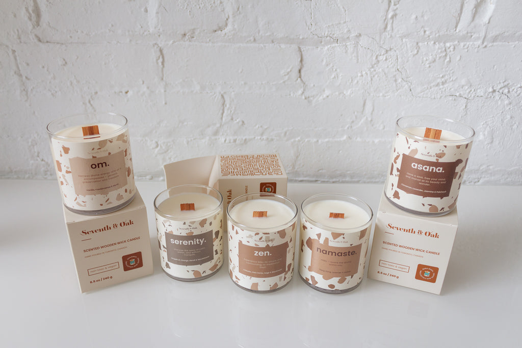 Wellness Collection Candles with Packaging boxes set on a white surface top