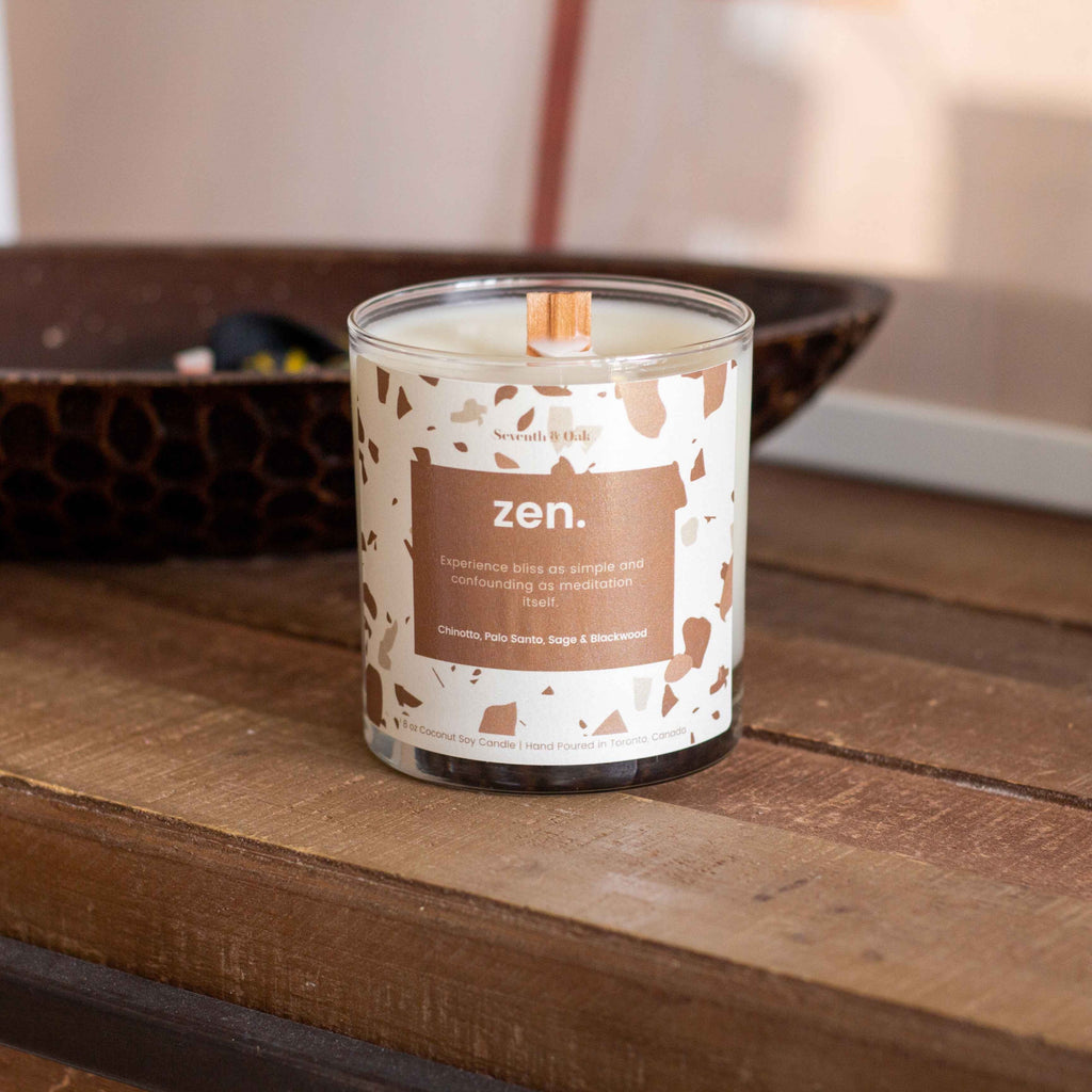 Zen candle on wooden table