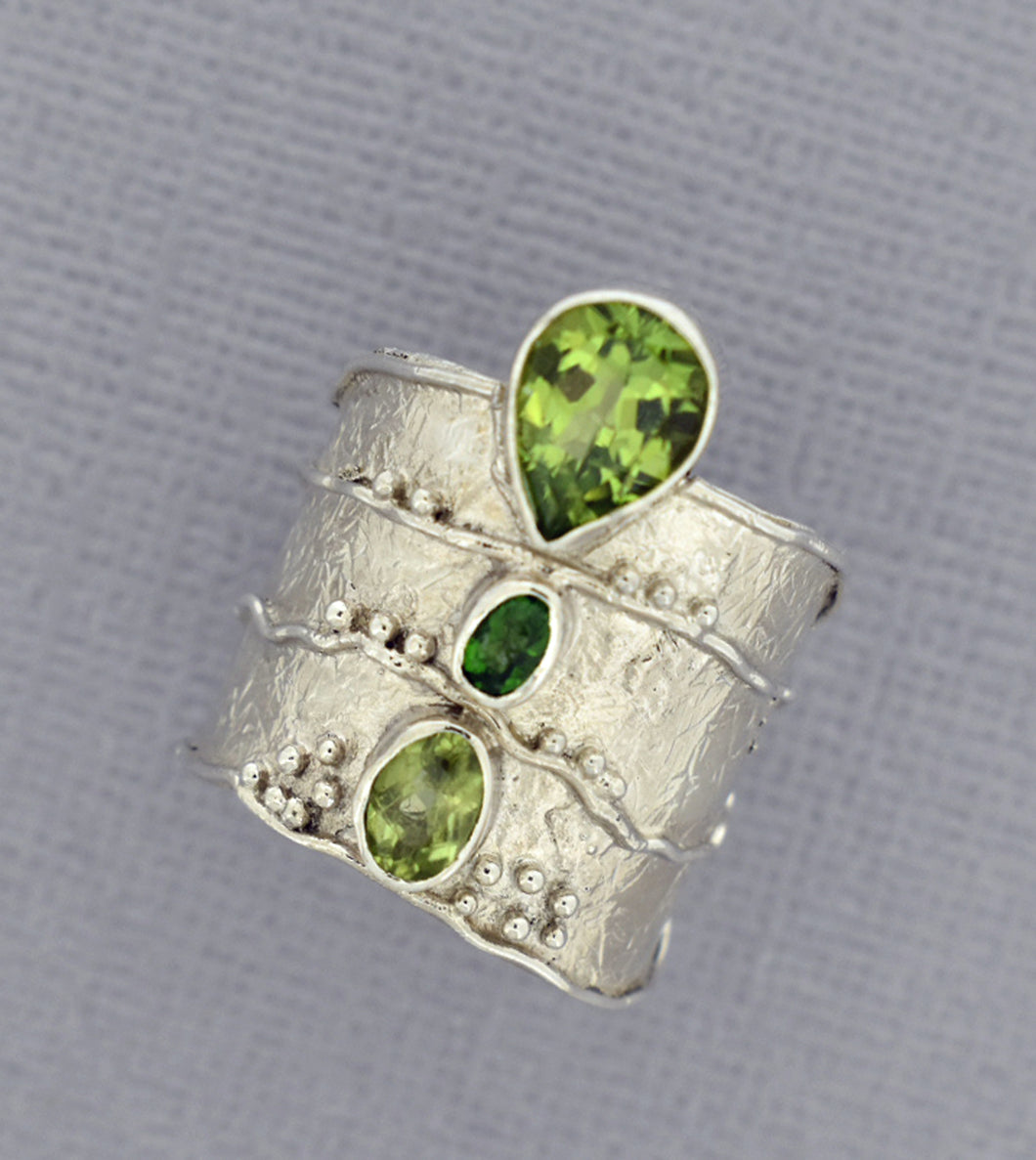 Three level Peridot Ring in Sterling Silver