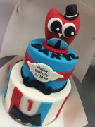 2 tier red and blue owl cake