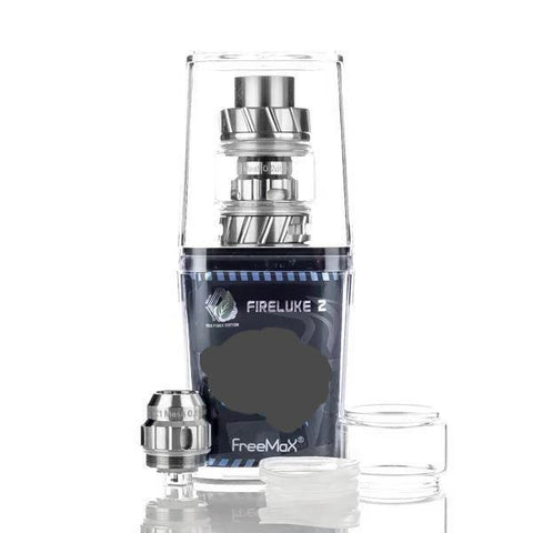 Freemax Fireluke 2 (coil) Tank, packaging. The Village Vaporette, Cambridge, Ontario, Canada, metal, updated version, great flavor, 360 degree e-liquid feeding, 90% tea fiber cotton