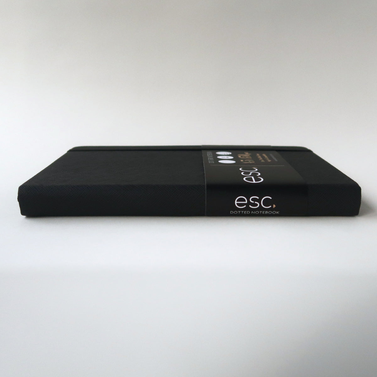 Esc. Goods Dark Mode Notebook Side View. A5, 150 gsm, black paper, high ink compatibility. Saffiano Leather.