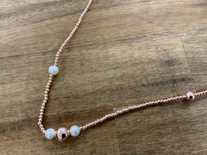 Fine long rose gold  and pearl necklace