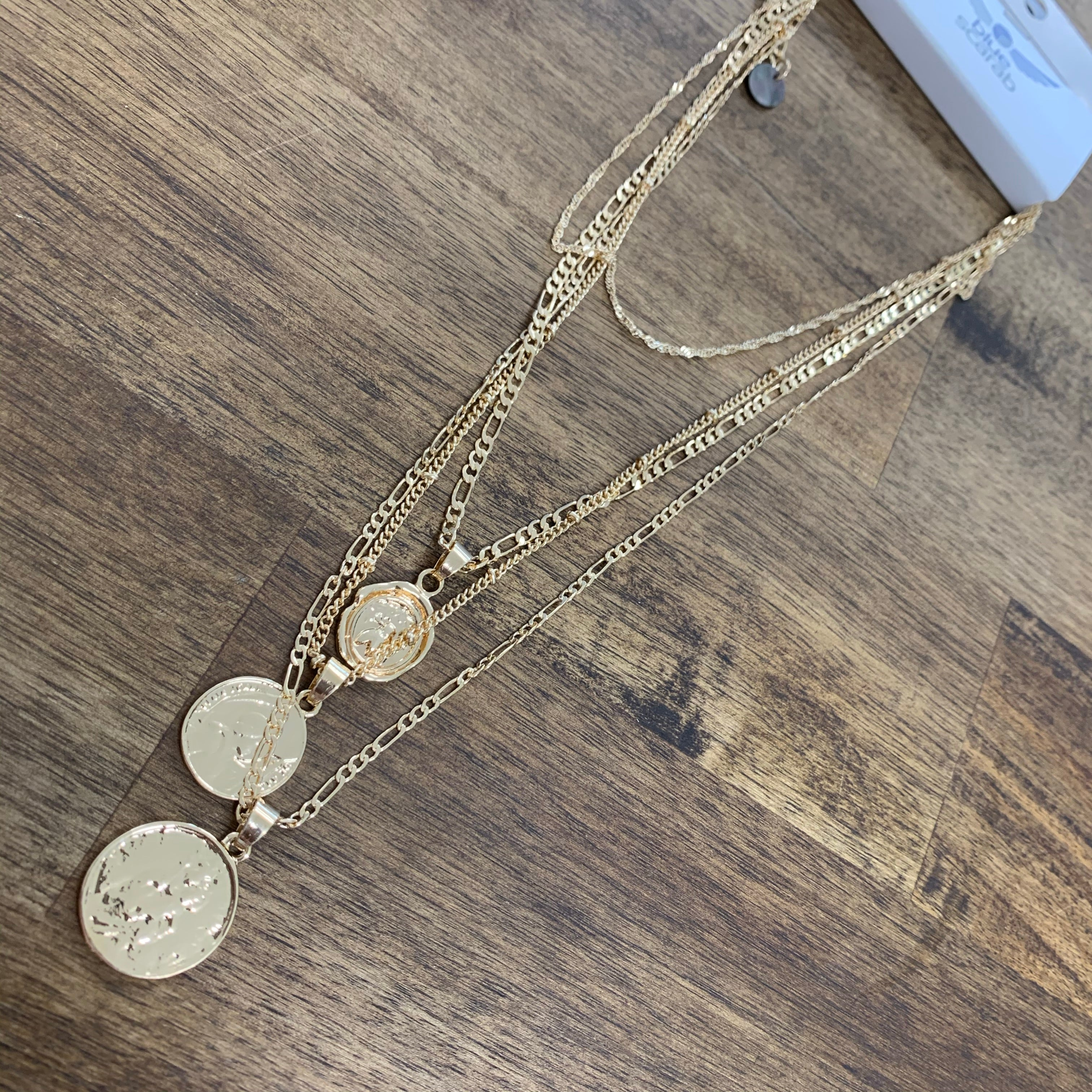 Gold layered necklace with large gold coins