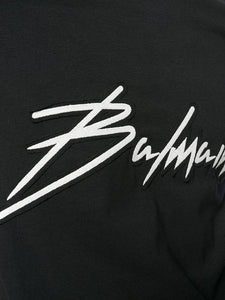 BALMAIN PARIS WHITE SIGNATURE LOGO TEE IN BLACK