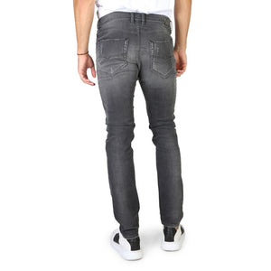 Black button fly closure jeans with pockets and logo details