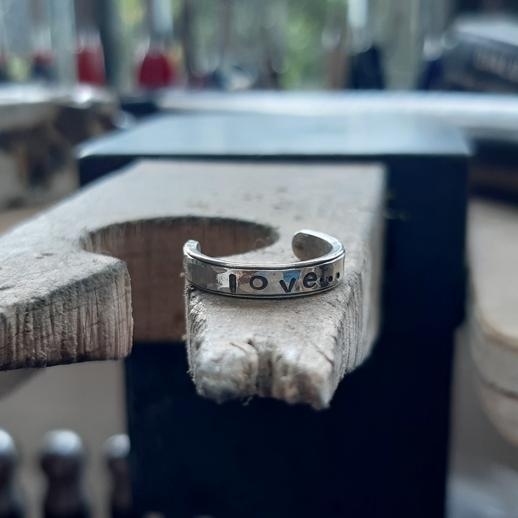 "Sterling silver toe ring with the word ""Love"""
