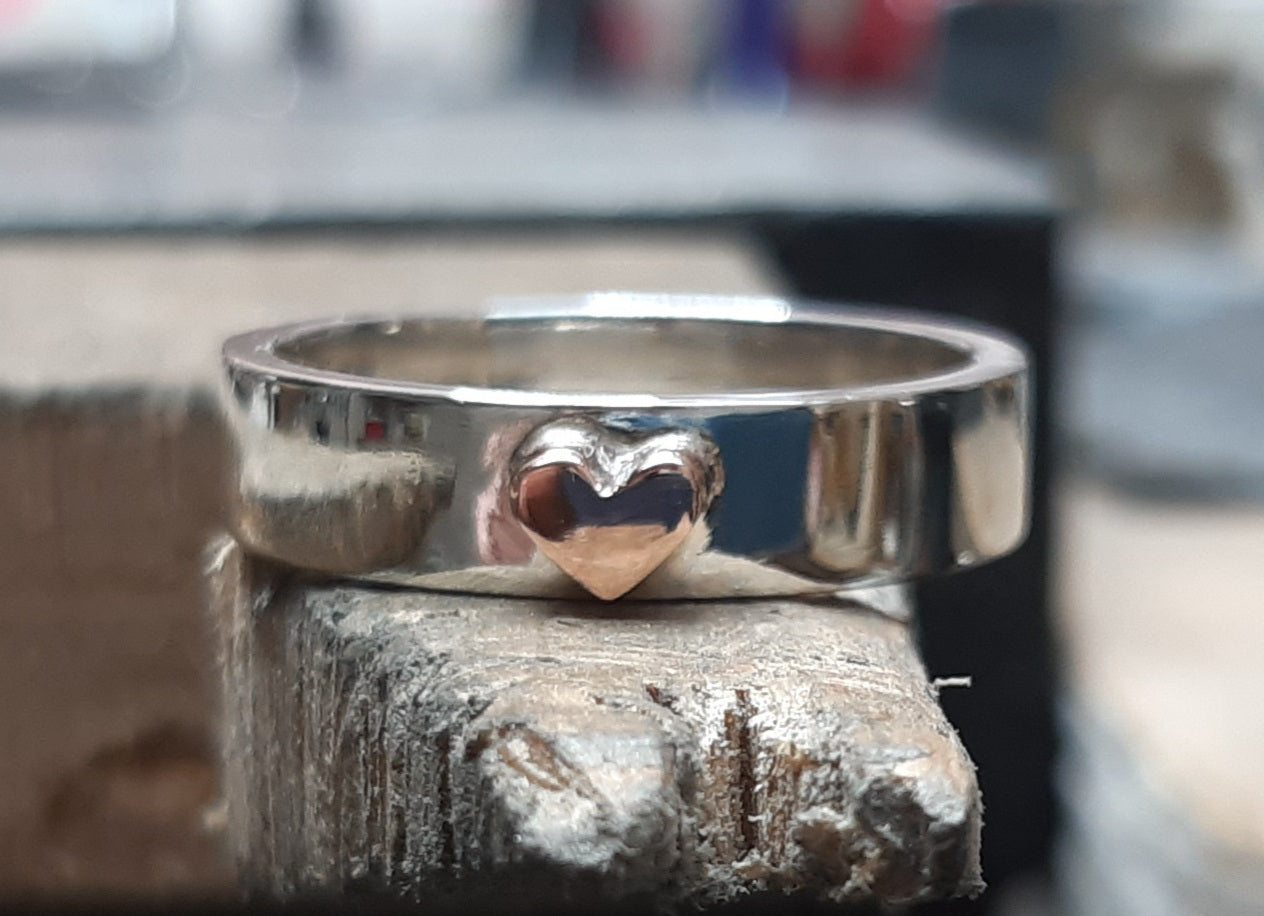 Silver ring with copper heart detail