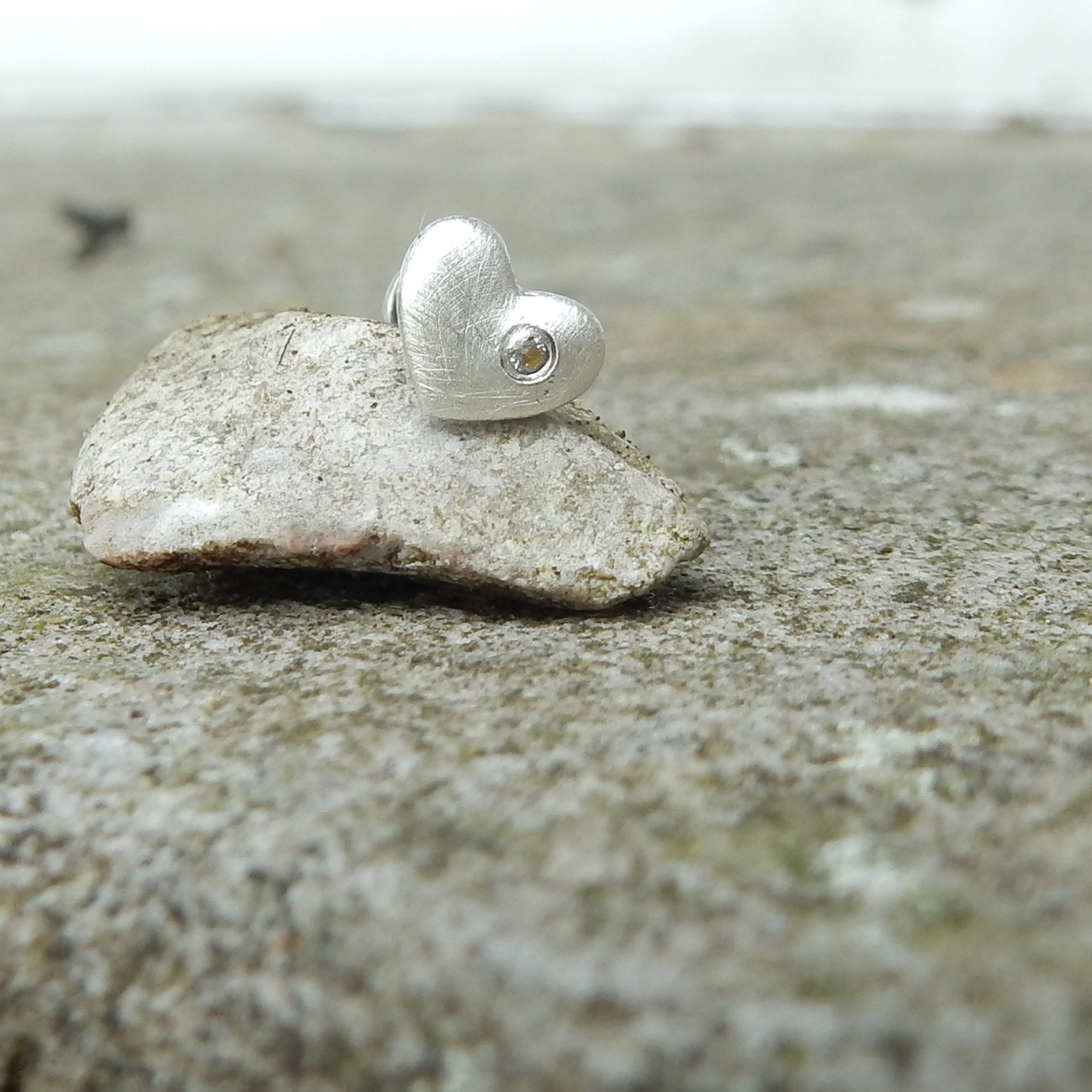 Brushed finished fine silver heart with a 1mm gemstone