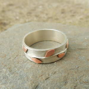 Silver ring with copper leaf detail