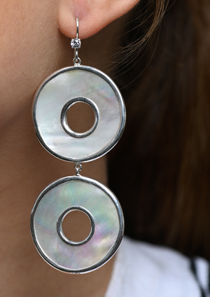 Mother of pearl discs set 950 sterling silver, with a diamond-cut Ceylonese white sapphire on the S hook.