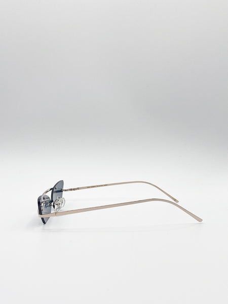 Rimless Cateye Sunglasses With Gold Frame And Black Lenses