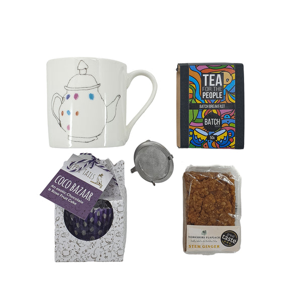 Illustrated china mug, loose leaf tea, ginger flapjack, luxury fruit cake.
