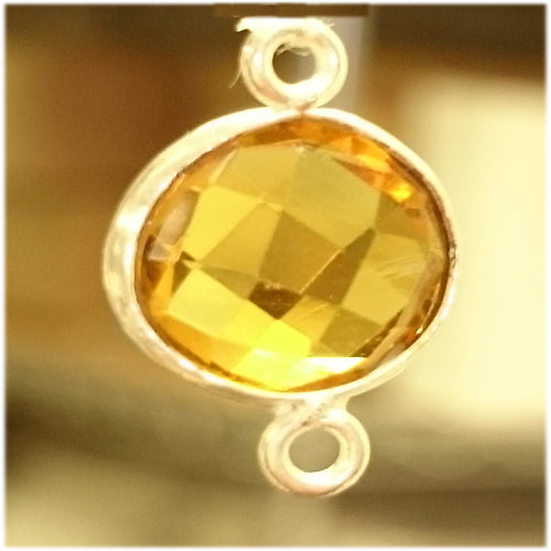 Stone Connectors & Drops. Sterling Silver 11.0mm Width / Length, Citrine Stone, Round Connector with 3.1mm Closed Ring on each side. Quantity Per Pack: 1 Piece.